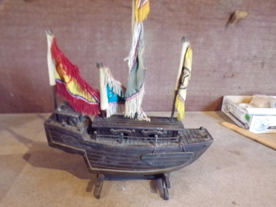 Wooden boat with stand