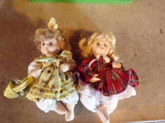 2 Porcelain Jointed Dolls McFIELD INTERNATIONAL CO.