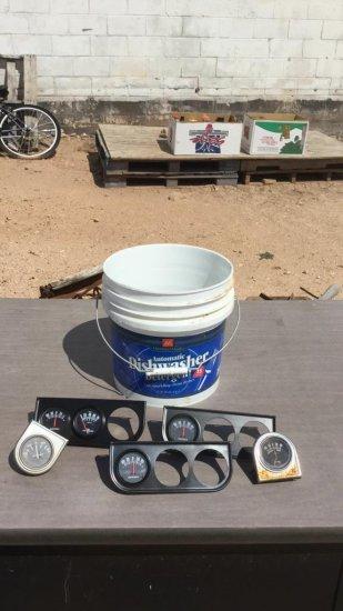 bucket of engine gauges