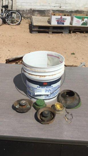 bucket of radiator caps