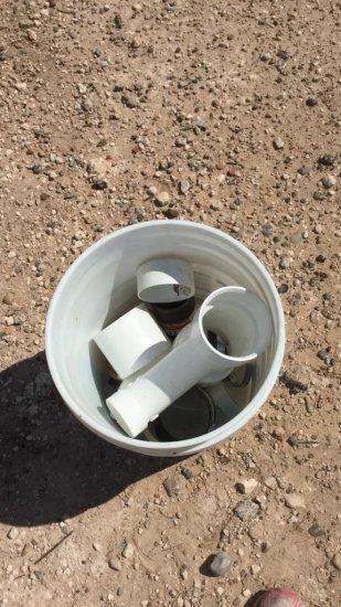 bucket of PVC fittings