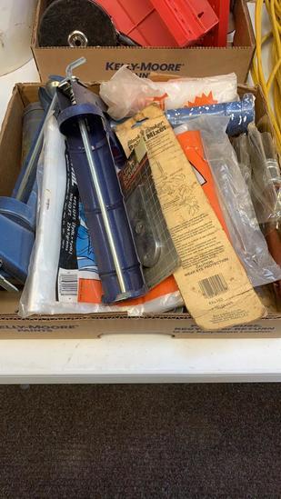 Box of caulking guns, scraper,paint brushes,drop