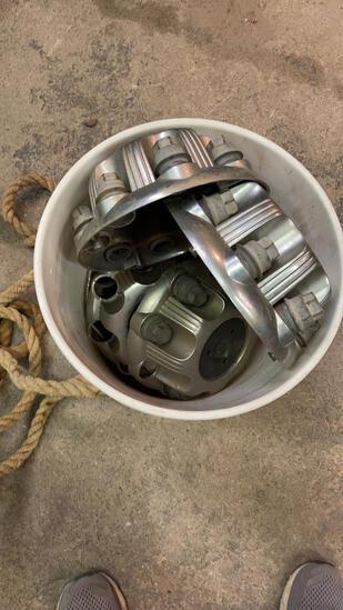 Bucket of hub caps