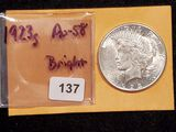 Purty 1923-S Peace Dollar in About Uncirculated 58