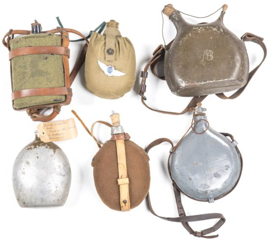 6 VARIOUS MILITARY WATER BOTTLES: Australian WWII with carrier & sling. French WWI with stopper & le