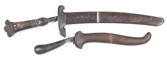 "LOT X 2: INDONESIAN SMALL KNIVES: g. 9½"" Yataghan shaped blade with a dark finish; carved horn hilt"