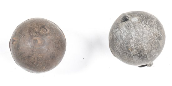 2 x FRENCH CAST IRON BALL GRENADES: incomplete, no screw tops; the letter A cast to one grenade & W