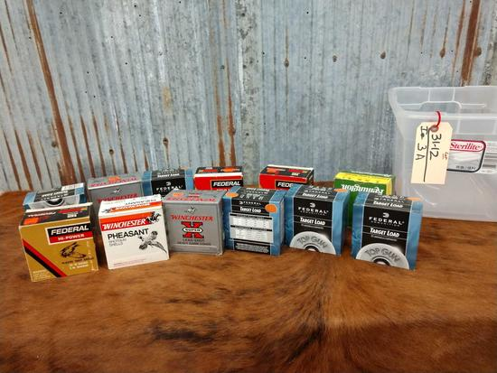 11 full boxes of 12 gauge ammo and one partial