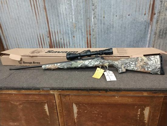 Savage Axis 243 bolt action rifle with scope