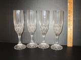 Lot - 4 Lead Crystal Champagne Flutes