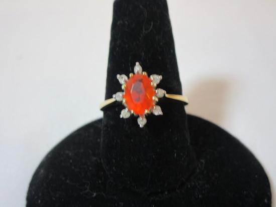 Oval Orange Opal w/ 8 Round Diamonds Mounted Around Opal. In 14k Yellow Gold Mounting
