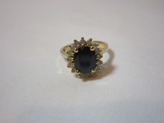 Oval Sapphire Mounted In 14k Yellow, Surrounded by 16 Diamonds - See Picture for Appraisal