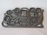 Cast Iron Mold of Christmas Toys