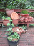 Lot - Green Metal Plant Stand & Misc. Molded Planters