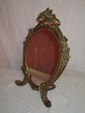 Oval Beveled Mirror in Ornate Standing Brass Frame  13 1/2