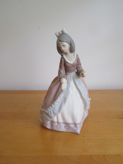 "Lladro Porcelain Figurine  7 1/2""  Missing umbrella & hand repaired"