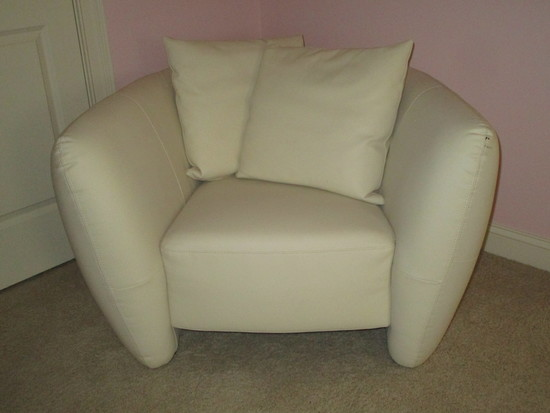 White Leather Chair w/Tufted Sides.  Small ink mark on arm rest, prick marks