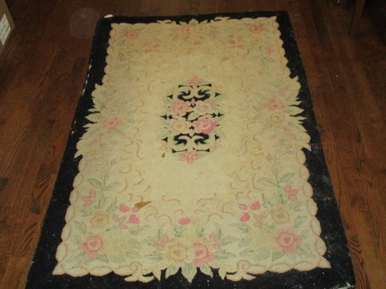 "Hooked Rug w/Black Border  Approx. 66"" x 42""  (See pics…some damage)"