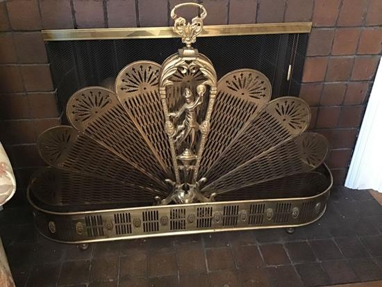Brass fireplace surround and cherub motif fireplace screen