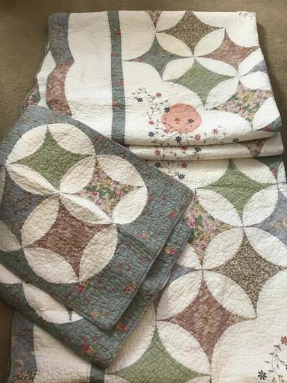2 twin sized quilts with shams one stained