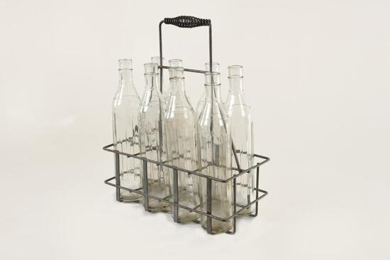 Lot Of 8 Quart Oil Bottles W/Rack