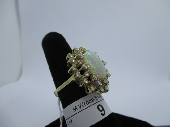 """Ring-14K opal & diamond, 16x11mm opal, size 6.5, 31 diamonds-5-6 pt. Thi s"