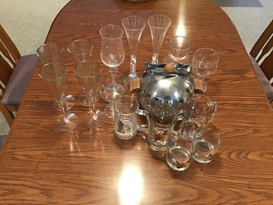 Ice Bucket w/ several glasses and 4 plastic wine glasses