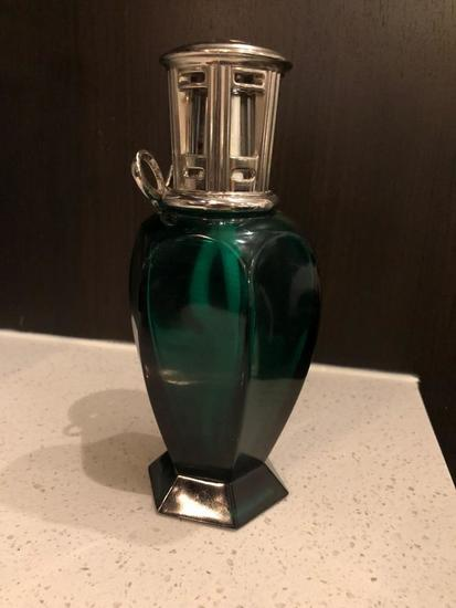 Lampe Berger Glass green fragrance bottle.
