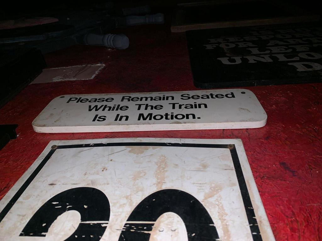 Please Remain Seated Sign