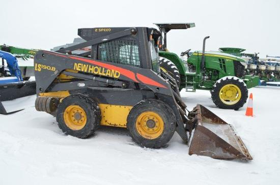 NH LS190 B skidloader w/ 2,390 hrs, 2 speed, cab-heat, rear weights, 12-16.