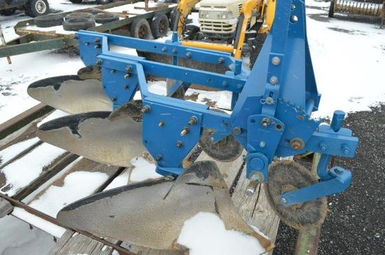 Ford 101 3 bottom, 3pt. plow, manual in office