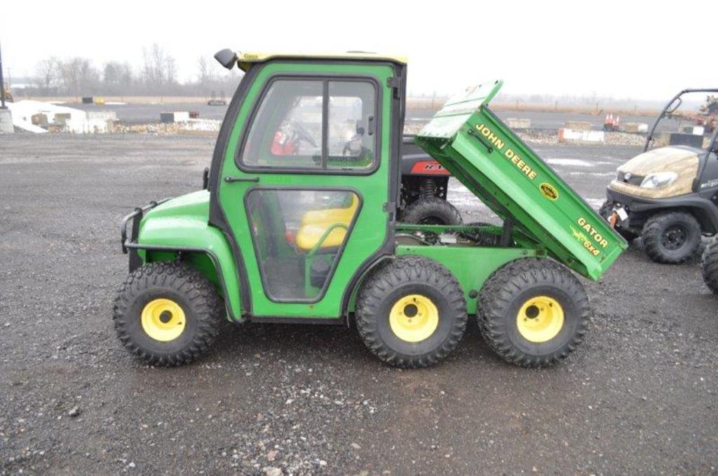 JD 6x4 Gator w/ 4wd, Curtis cab, 1,050 hrs, 4wd, electric dump