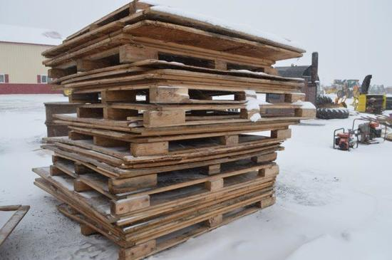 3 stacks of pallets and plywood