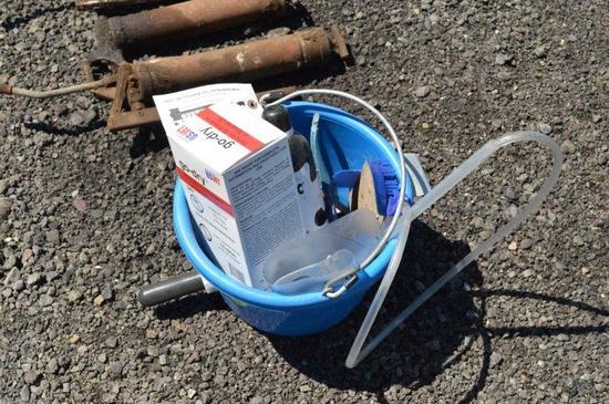 bucket of misc dairy supplies