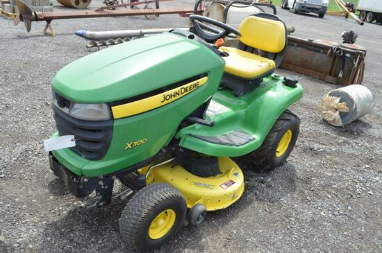 JD X300 riding mower w/ 647hrs, 42'' deck