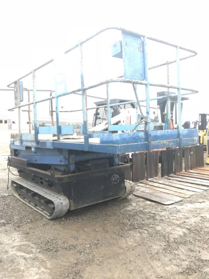 Blue Scissor Lift with tracks, electric
