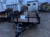 New Twin axle trailer 6 1/2 x 16 feet with ramps