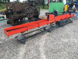 Vibrating conveyor with grinder infeed