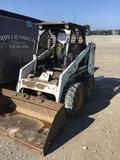 Bobcat 734B skid loader with bucket.