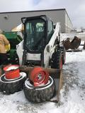 1145- Bobcat S850 Skidsteer, enclosed cab, extra rims and tires included