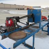 24 in. chop saw w/18 hp Honda & 15 ft. roller table, works good;