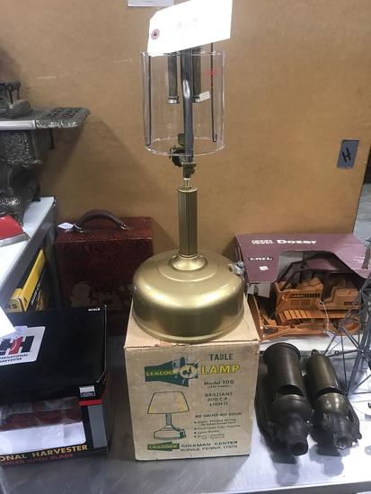 NOS Coleman model 100 table lamp with original invoice.