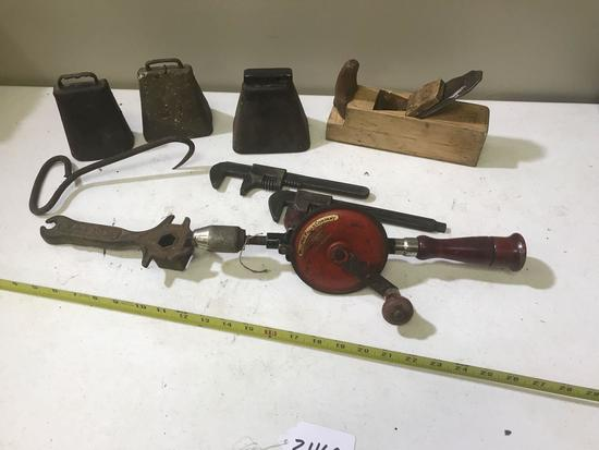 Cowbells, Millers Falls Drill, Wooden Plane, and 3 wrenches including one embossed with Ford