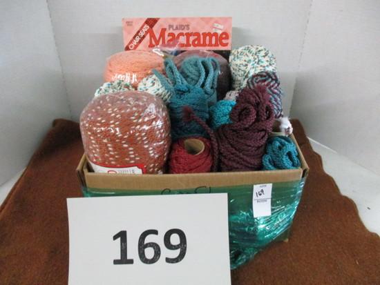 box of macrame cord and books
