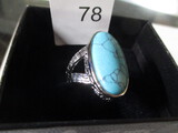 costume ring with blue stones