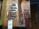 Pocket knives, belt, gun case