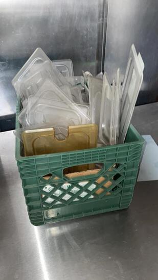 Crate of plastic lids