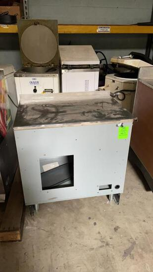 Metal cabinet with stainless top