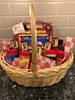 $100 Famous Daves Gift Card and basket of Goodies
