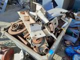 Rolling dumper hopper full of Gear parts, scrap metal, yrd